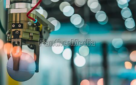 closeup robot hand machine picking up