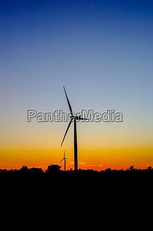 wind turbine outline on red and