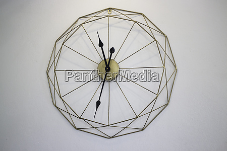 vintage clock on white wall background