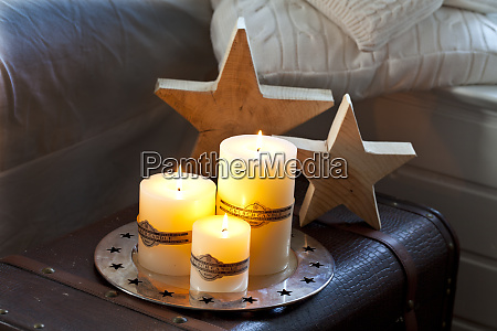 winterly decoration with candles and star