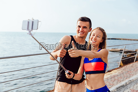cheerful friends taking a selfie on