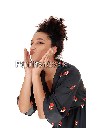 beautiful woman blowing a kiss with