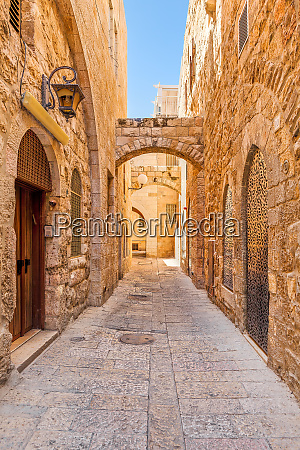 narrow street among old stone walls