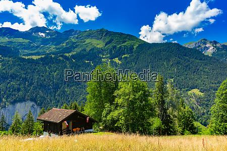 lonely house in swiss alps switzerland