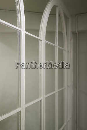 mirror wall reflecting interior design scene