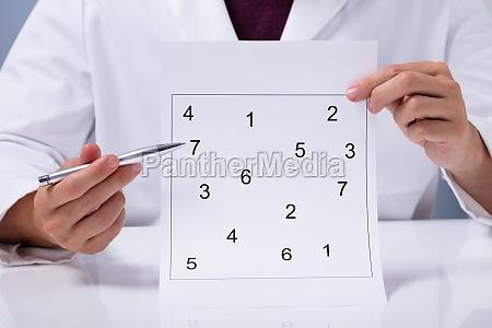 doctor holding neurological test