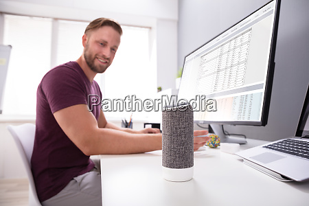 businessman using voice assistant