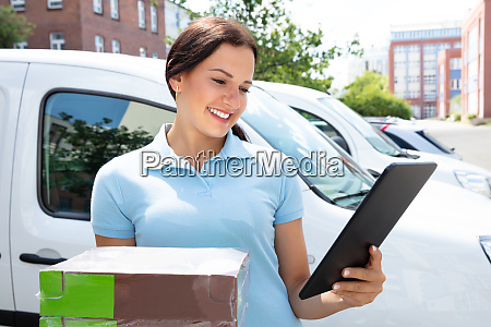 delivery woman holding cardboard box and