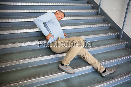mature man lying on staircase