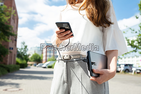 woman charging mobile phone