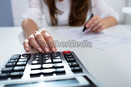 businesswoman calculating invoice