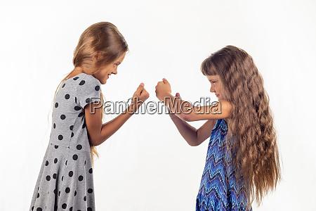 two girls are fighting studio white