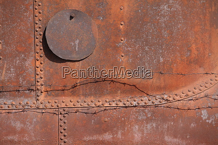 rusty steel with rivets