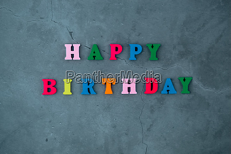 the multicolored happy birthday word is