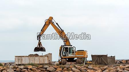 industrial excavator working on construction site