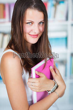 pretty female college student studying in