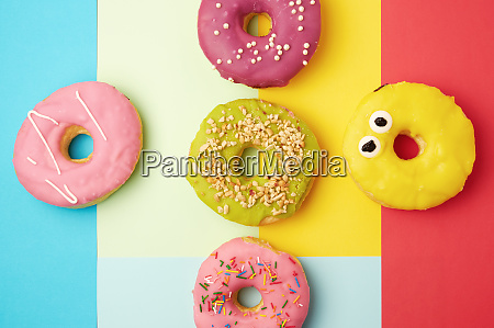 round different donuts with sprinkles