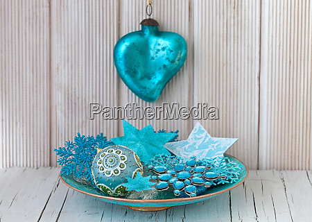 blue turquoise christmas ornaments in a