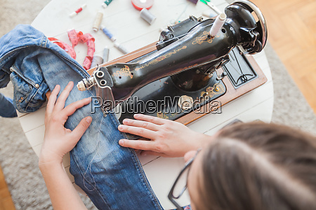 f female tailor working with old