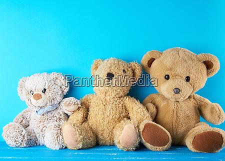 many teddy bears on a blue