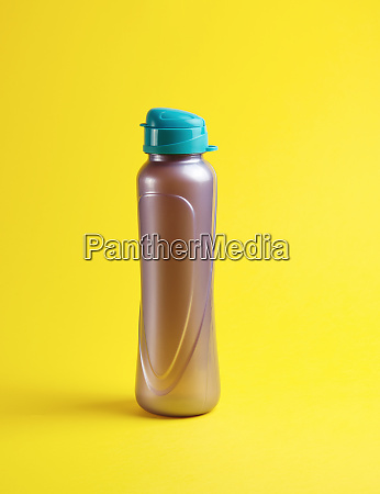 closed plastic sports bottle on a