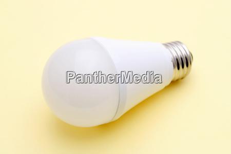 led energy saving bulb on yellow