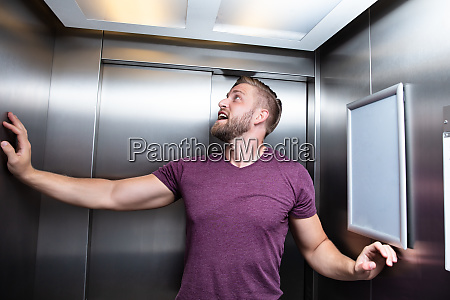 man trapped in elevator