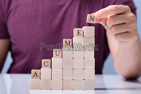 person placing last alphabet of word