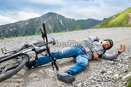 man after accident on mountain bike