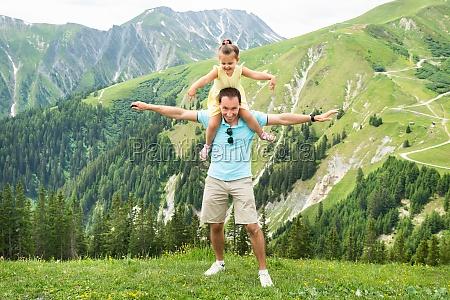 girl and father having fun in
