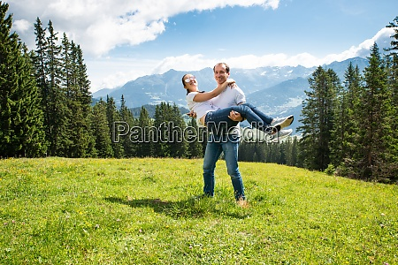 man carrying woman in mountains