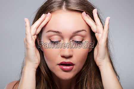 woman doing face fitness exercises