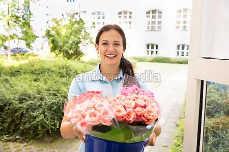 female florist delivering flower rose bouquet