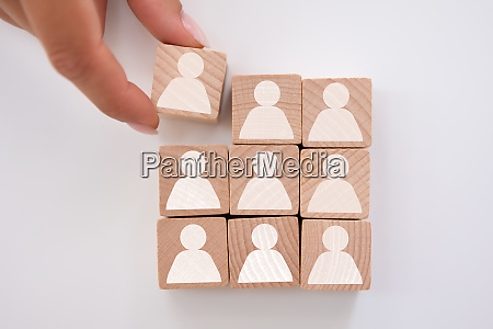 businesspersons hand holding cubic block