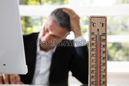 businessman working during hot weather