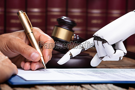 robotic hand assisting person for signing