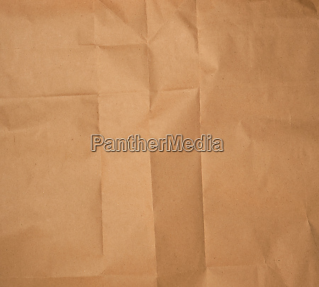 crumpled brown sheet of paper full