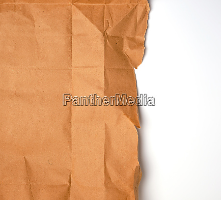 torn piece of brown craft paper