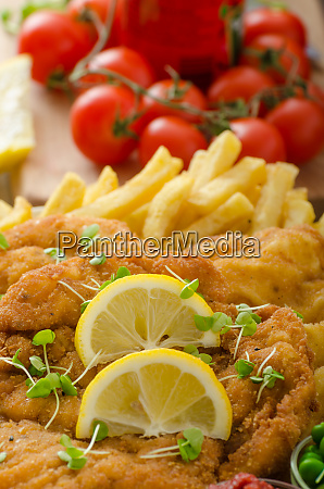 schnitzel french fries and microgreens salad