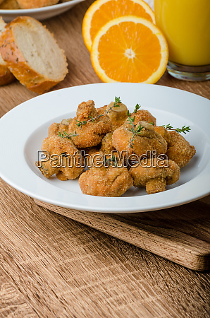 breaded fried mushrooms with juice
