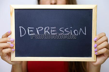 depression written on the blackboard holding