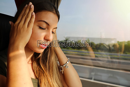 young woman suffer sickness during travel
