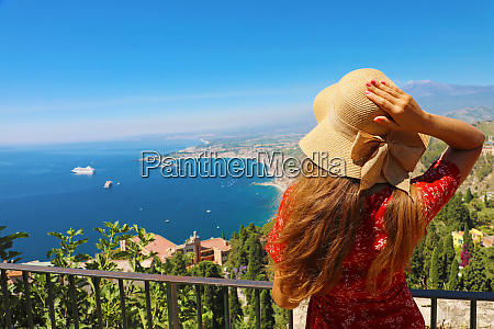beautiful woman with hat enjoying view