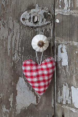 red white fabric heart hanging from