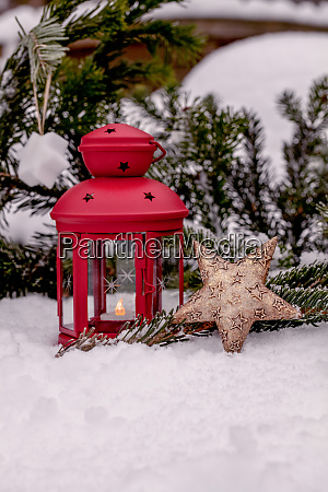 christmas star ornament in the snow