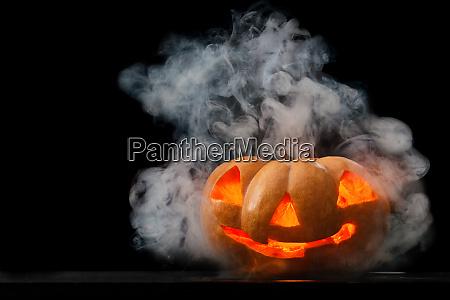 halloween pumpkin with smoke