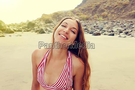 happy smiling bikini girl on the