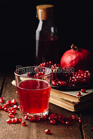 glass of cocktail with pomegranate juice
