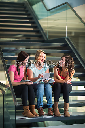 group of university students studying hard