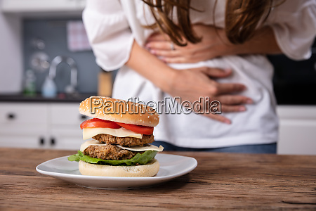 woman holding burger in hand